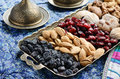 Mixed dried fruits and nuts in oriental style assorted on brass tray raisins almond cranberry figs walnut Stock Images