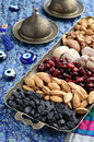 Mixed dried fruits and nuts in oriental style assorted on brass tray raisins almond cranberry figs walnut Royalty Free Stock Image