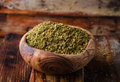 Mixed east spice - zaatar or zatar in vintage bowl on wooden background. Selective focus Royalty Free Stock Photo