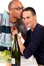 Mixed ethnicity  gay couple kitchen Stock Photo
