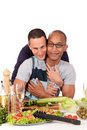 Mixed ethnicity  gay couple kitchen Stock Images