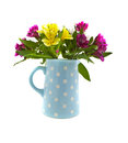 Mixed flowers in blue jug Stock Images