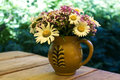 Mixed Flowers In A Clay Jug