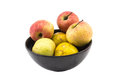 Mixed fruit in black bowl still life on white background Royalty Free Stock Photo