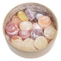 Mixed fruit candies in tin jar. Royalty Free Stock Photos