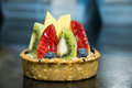 Mixed fruit tart. A custard base tart filling Royalty Free Stock Photo