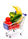 Mixed fruit and vegetables in a mini shopping cart isolated on full with banana cucumber tomato broccoli white Royalty Free Stock Images