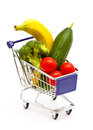 Mixed fruit and vegetables in a mini shopping cart isolated on full with banana cucumber tomato broccoli white Royalty Free Stock Photos