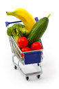 Mixed fruit and vegetables in a mini shopping cart isolated on full with banana cucumber tomato broccoli white Royalty Free Stock Photography