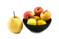 Mixed frut in black bowl and chinese pear still life on white ba Royalty Free Stock Photo