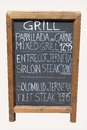 Mixed grill cafe sign on old wooden blackboard Royalty Free Stock Photo