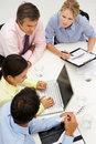 Mixed group in business meeting around table Stock Photo