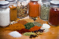 Mixed herbs and spices on a wooden table surface Stock Image