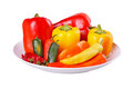 Mixed hot and sweet peppers in a bowl isolated on white Royalty Free Stock Photo