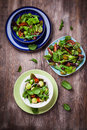 Mixed low calorie salads with olives and fresh avocado Royalty Free Stock Image