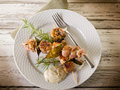 Mixed meat skewer on dish Stock Images