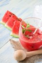 Mixed melon in a glass with ice and straw Royalty Free Stock Photo