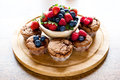 Mixed muffins fruits on wooden board old table Royalty Free Stock Photography