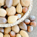 Mixed nuts in the basket and on table Royalty Free Stock Photography
