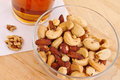 Mixed nuts with beer Royalty Free Stock Photo