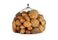 Mixed nuts in a net on white background Royalty Free Stock Photography