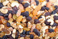 Mixed nuts and raisins food background Stock Photo