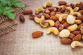 Mixed nuts on wooden background the Stock Images