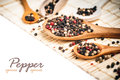Mixed peppercorns wooden spoon Royalty Free Stock Image