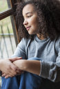 Mixed Race African American Girl Looking Out of Window Royalty Free Stock Photo