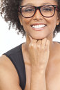 Mixed race african american girl wearing glasses a beautiful intelligent or young woman looking happy and geek Royalty Free Stock Photography