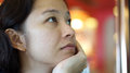 Mixed race Asian girl close up face. Looking up think and wait Royalty Free Stock Photo