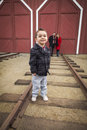 Mixed race boy at train depot with parents smiling behind young adorable Stock Photo