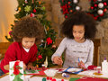 Mixed race children making Christmas cards Royalty Free Stock Photos
