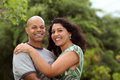Mixed race couple outside a happy relax in the back yard or garden with copy space Royalty Free Stock Photography