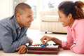 Mixed race couple playing solitaire Royalty Free Stock Photo