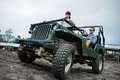 Mixed race couple riding a jeep off road portrait of doing some adventure Stock Images