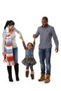 Mixed race family with cute little girl walking Royalty Free Stock Photo