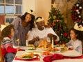 Mixed race family having Christmas dinner Royalty Free Stock Photography