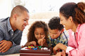 Mixed race family playing solitaire Royalty Free Stock Photo