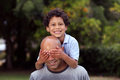 Mixed race father and son play in the back garden Royalty Free Stock Photo