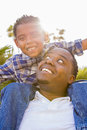 Mixed Race Father and Son Playing Piggyback Stock Photography