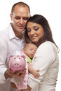 Mixed Race Parents with Baby Holding Piggy Bank Stock Images