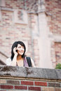 Mixed race student on the phone Royalty Free Stock Image
