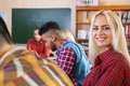 Mixed Race Students Group With Professor Sit Desk University Classroom, Beautiful Blonde Young Girl Wear Checked Shirt Royalty Free Stock Photo