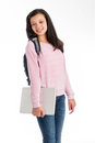 Mixed race teenage girl holding a laptop computer weraing casual cloths and jeans isolated on studio white background Stock Photo
