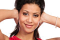 Mixed race woman closing ears with hands. Royalty Free Stock Photo