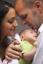 Mixed Race Young Family with Newborn Baby Stock Photography