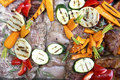 Mixed raw meat and grilled vegetables marinating ready for barbe Royalty Free Stock Photo
