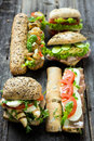 Mixed sandwiches on a wooden background Stock Image