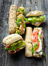 Mixed sandwiches on a wooden background Stock Images